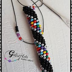 Image may contain: jewelry Bead Crochet Patterns, Bead Crochet Rope, Beading Patterns, Crochet Beaded Bracelets, Beaded Jewelry, Beaded Earrings, Jewelry Bracelets, Bijoux Diy, Bracelet Tutorial