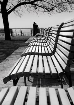 Artist: Kresimir Kopcic; he takes a picture of his subjects from a long distance and uses the benches lines to lead the eye to them