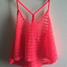 Victoria's Secret pink crochet neon crop tank New with tags. Adorable bright pink/coral crochet racer back tank. Slightly cropped. Flowy. Looks great over a swim suit! XS but also will for a small since it is has a loose, flowy cut. Victoria's Secret Tops Tank Tops