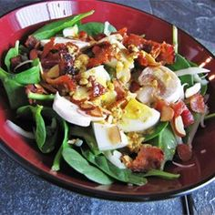 Spinach Salad with Warm Bacon-Mustard Dressing Recipe--sub almonds with walnuts; chop the eggs; sub crumbled goat cheese for Swiss; and more bacon!!