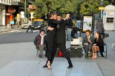 Tango in the Street - Recoleta - Buenos Aires    Right at the west end of Av. Quintana, this couple has set up a dance area with top hats placed in front to collect donations. The speaker is playing tango music, but there's another person's speaker nearby playing the classical music of Carlos Gardel.