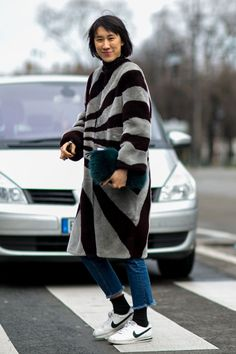 Pin for Later: See the Best Street Style From All of Paris Fashion Week Day 5 Eva Chen wearing Nike Cortez.
