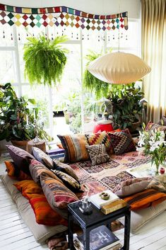 low to the ground seating and colorful patterns, natural light and indoor plants