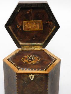 """Georgian Oyster-Walnut Hexagonal Tea Caddy Interior, inlaid initials G H to underside of lid, 6""""h; 5""""w; 5""""d from Liveauctioneers"""
