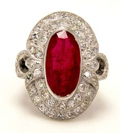GIA Certified 4.70CT Antique Vintage Ruby and Diamond Cluster Ring in 18k White Gold ,CIRCA 1940s by TreasurlybyDima on Etsy https://www.etsy.com/listing/168894304/gia-certified-470ct-antique-vintage-ruby
