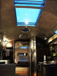 No bright colors here, this Airstream features dark tones, huge skylights, and a super-modern kitchen.