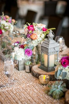 Woven table cloths added a sparkling effect to this rustic wedding reception table. Other decorations included succulents, candles in lanters, pink floral centerpieces in wood planter boxes and woodcuts with terrarium jars. | Lauren & Devin's Colorado Real Wedding by Daylene Wilson Photographic - from mywedding Magazine (#myweddingmag)