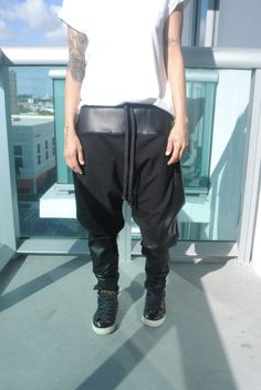 Black faux leather and cotton lycra drop crotch pants for men and women. $75.00, via Etsy.