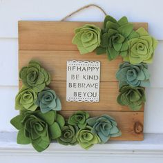 Handpainted wooden wall sign with felt flowers and succulents