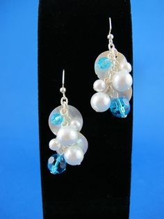 Items similar to silver plated chain dangle earrings with pearl and topaz blue rhinestone beads, round shell pieces and silver plated earring backs on Etsy Topaz, Silver Plate, Dangle Earrings, Dangles, Chain, Trending Outfits, Unique Jewelry, Handmade Gifts, Blue
