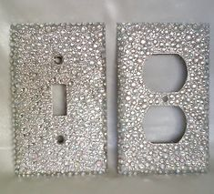 "Add some bling to any room with this sassy light switch cover! It is approximately 4 1/3"" long by 2 3/4"" wide and is a silver metal light switch plate. The top features silver glitter with clear & AB iridescent round multi-size rhinestones throughout. Comes with two silver screws to hold in place on the wall. We also sell the matching outlet cover, business card case, flask and funnel!"