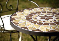 Mesa de mosaico. Artesania en forja. jardin terraza www.fustaiferro.com