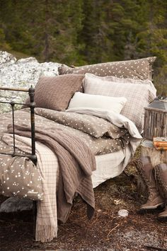 Chocolate and Cream.  (oh man, if I ever have to live in the woodlands, I hope my bed looks just like this!)