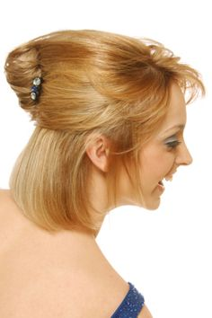 small hair styler being used on the lower half of the head www ...
