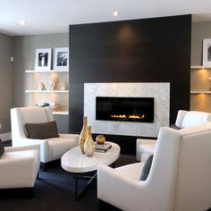 clean & slightly modern. cozy seating by the fireplace is nice. also love the floating shelves
