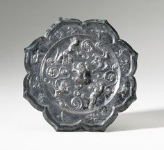 A bronze 'Phoenix and Mythical Beasts' octafoil mirror, Tang Dynasty