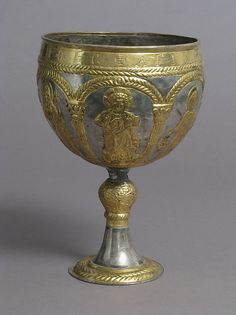 The Attarouthi Treasure - Chalice   Date: 500–650  Geography: Made in Attarouthi, Syria  Culture: Byzantine  Medium: Silver and gilded silver  Dimensions: Overall: 9 9/16 x 6 5/8 in. (24.3 x 16.8 cm) Diam. of foot: 3 7/8 in. (9.9 cm) Diam. of knop: 1 5/8 in. (4.1 cm) Capacity of cup: 2100 ml  Classification: Metalwork-Silver