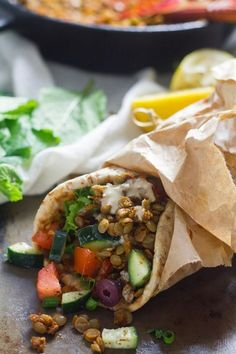 Lentils are quickly cooked up with spices and stuffed into pita bread with zesty salad and tahini sauce to make these mouth-watering vegan shwarama wraps.