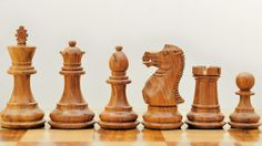 Wooden Weighted Hancarved Chess Set Shesham Wood ( Golden Rose Wood ). http://www.chessbazaar.com/chess-pieces/wooden-chess-pieces/wooden-weighted-hancarved-chess-set-shesham-wood-golden-rose-wood.html
