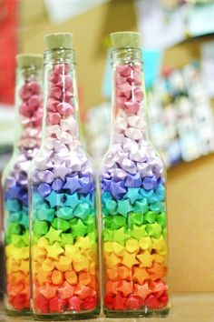 CRAFT IDEA: Make these Origami stars using coloured paper put them into glass bottles jars for decoration!