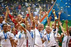 U.S. players celebrate after winning the World Cup final, 5-2, against defending champion Japan at BC Place Stadium on Sunday in Vancouver, British Columbia.
