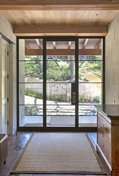 glass and steel front door for blending outdoors and indoors