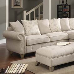 Pairing button-tufted upholstery and a nailhead trim, this inviting left-facing loveseat infuses your living room or den with contemporary style.