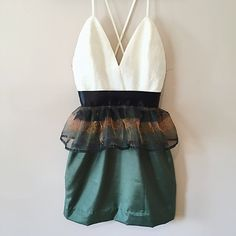 A Ballerina Birthday - $209.00  Size 2  Fitted cream colored bodice with flowery textured print. Shiny green straight skirt with stripe printed tulle peplum. Fully lined bodice, back zipper closure, made from high quality woven fabrics.  100% upcycled.
