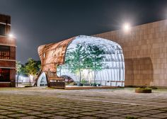 South Korean studio Shinslab Architecture sliced off one end of a rusty old ship and turned it upside down to form this installation for the Seoul edition of MoMA's Young Architects Program