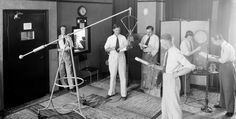#ThrowbackThursday Check out this Radio Studio from the 1930s! A group is broadcasting dramatized news while a couple foley artists provide sweet sound effects. #TBT Image via The Library of Congress