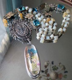 'bohemian garden' necklace with glass locket with pressed flowers by The French Circus, $215.00