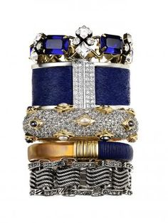 A mix of textures and sizes is a great way to stack your bracelets #moremagazine