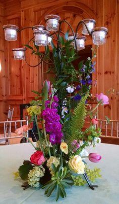 Tabletop candletree w/spring flowers.  In bloom, ltd.