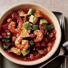 Spicy Tortilla Soup with Shrimp and Avocado Recipe Soups with olive oil, onions, celery, carrots, chipotle chile, ground cumin, chili powder, minced garlic, lower sodium chicken broth, white hominy, fire roasted diced tomatoes, medium shrimp, fresh lime juice, salt, baked tortilla chips, avocado, cilantro leaves