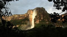Venezuela Angel Falls (Salto del Angel) is the world's highest waterfall, 3,212 ft tall. It is located near the village of Canaima in southeastern Venezuela and is accessible to tourists only by five-hour canoe trip through the surrounding tropical forest.