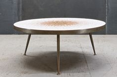 Italy, c.1950s. A rare mosaic topped three legged coffee table by Gio Ponti. Three Independant Solid Brass Legs support this Brass Edge Banded Sunburst Patterned Ceramic Tile Circular Top. Appears to be Hand Made, with Pencil Markings on Bottom, Heavy Natural Time-Aged Patina to Brass Surfaces. Very Good Vintage Condition. More Info to come.    Dia: 36 x H: in. ½ ¼    $5500 Inquire to Dino@Modern50.com
