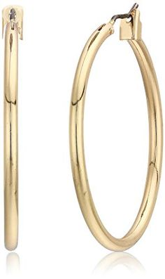 40cb86858 These gold tone hoop earrings feature a classic style and click-it closures.