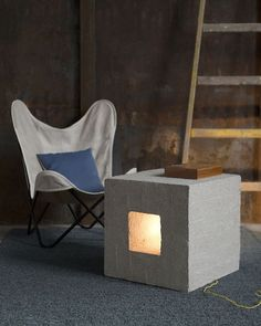Eco-conscious furniture is all about buying better, buying less, going multifunctional. This Tumba Light Cube is not only gorgeous, its made of recycled paper that looks and feels like concrete. So lightweight. Tumba is also a lamp, a stool, a side table and a decor piece. Available at www.greendesigngallery.com/products/tumba-cube from award-winning design firm @indi.lt #homedecor #lamp #furniture #sidetable #stool