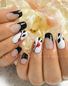Black and white with a dash of red petals. Simple and graceful. Tipped with black acrylic paint, the nails are also adorned by a plain white base with black leaves lacing over the white like a canvass.