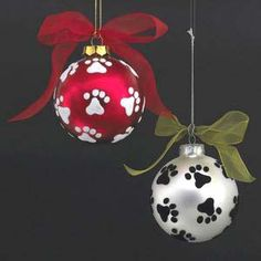"Paw Prints on Silver Glass Ball Ornament, from Dogstuff.com. Decorate your tree with a touch of puppy love! Silver ball ornament has black paw prints around it. Ball is 3.15"" in diameter."