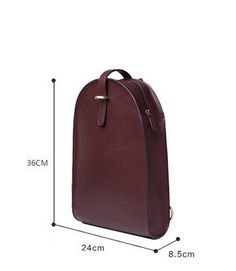 Sophisticated and functional structured backpack. Unique upside down rounded U shape with zip closure and adjustable leather straps . The interior has two slide