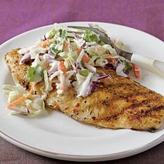 Jerk-Rubbed Catfish with Spicy Cilantro Slaw | MyRecipes.com - might so well as fish taco?  Read reviews....really spicy when made as recipe states....less pepper for Michael