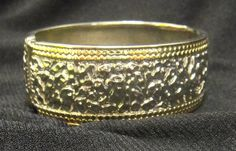 Silver cuff with gold accents.  Hinge bracelet