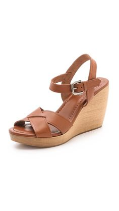 These are super comfortable and the nicest neutral color: Madewell Wylie Wedge Sandals