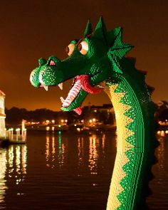 Brickley, the giant sea serpent lego sculpture who rises from the lake outside the Lego store at Downtown Disney. I'd never noticed how silly / puppylike his tongue looks from the side before. Mythical Sea Creatures, Lego Sculptures, Sea Serpent, Lego Store, Downtown Disney, Lego Disney, Legos, Imagination, Christmas Ornaments