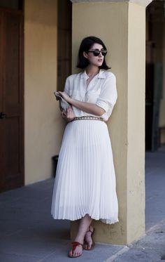 Perfection from her head to her little orange toesies. via The Sartorialist. #white