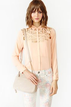 Blouse with lattice cutout detailing