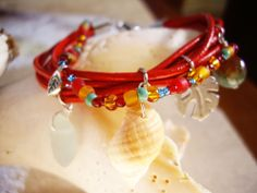Bohemian - Red leather bracelet - Sea glass, jasper, pewter and seashell - Length of bracelet including clasps: 71/4″ (18.5cm) - 64.95$ - See this unique piece on seaucollection.com