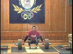 Klokov - 205 kg Snatch - 2012    This bar looks tiny next to him.
