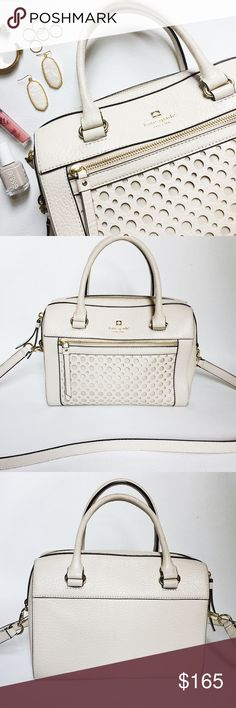 "Kate Spade Perri Street Delaney Leather Bag Kate Spade Perri Street Delaney Leather Bag in a light beige featuring cut out bubble design.  Pebbled leather and roomy interior.  Inside side zip pocket and removeable long strap.  Pre-loved but in great condition.  Scuff marks on handle and at corners, see pics.  No scratches or damage to leather, marks may come clean with leather cleaner.  Overall, these signs of wear are minimal.  Authentic, no trades.   Measurements: 9.5"" H x 11"" W x 5.75"" D…"